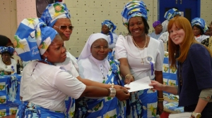 Members of the Nigerian Catholic Chaplaincy Women's Association present their donation to CAFOD's Elizabeth Lingard