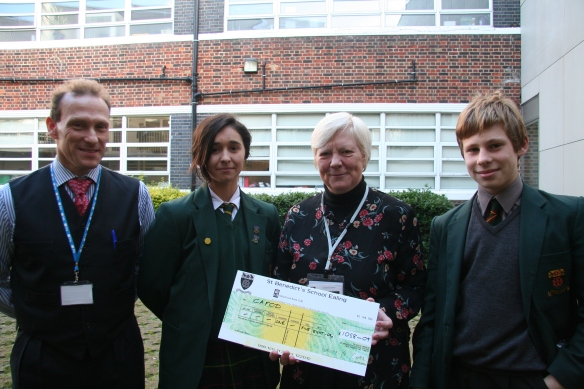 From left: Event organiser Mr Scicinski, winning student Rebecca, CAFOD volunteer Maggie Beirne and student Marcin, who raised the most sponsorship money.