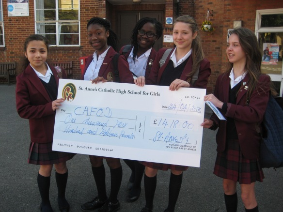 Students from St Anne's lower school with the cheque for the money they raised.