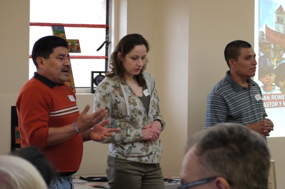 Erasmo and Fidel talk to CAFOD supporters at the Catholic Church of Christ the King with Tania of CAFOD's Latin America team translating.