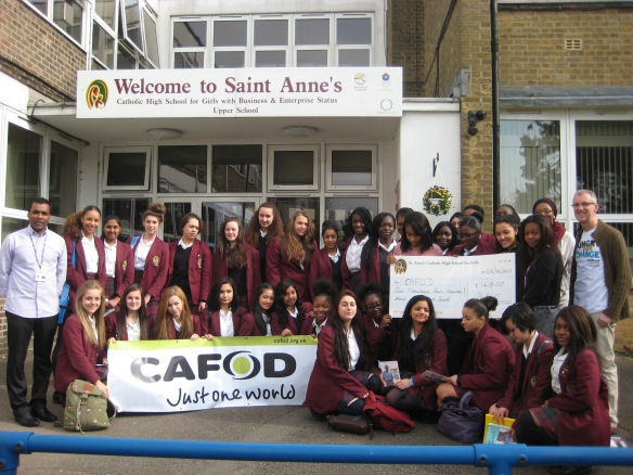 St Anne's upper school students and Chaplain John Ravi (far left) present the cheque to CAFOD's Tony Sheen (far right).