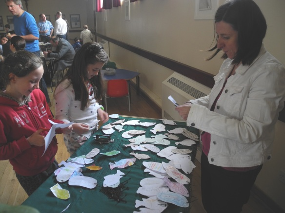 Parishioners at St Hugh of Lincoln, Letchworth, write personal messages about their thoughts on hunger on loaves and fish.