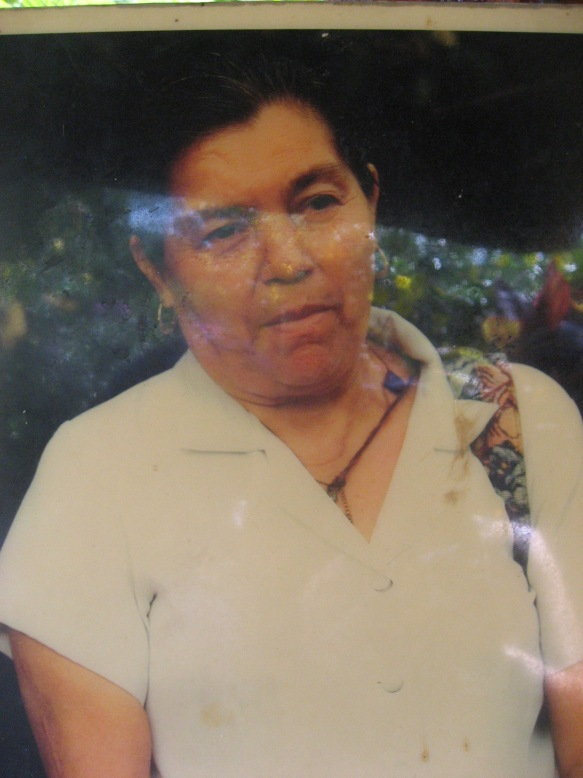 A photograph of Rufina Amata, a survivor of the massacre.