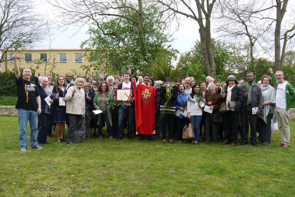 Sing Hosanna! CAFOD staff and volunteers with their greenery prior to Palm Sunday mass