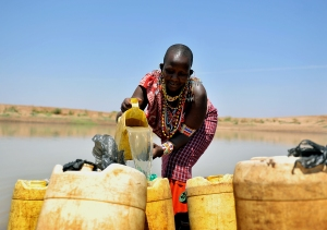 Maasai lady collecting water from a pond built with CAFOD help.