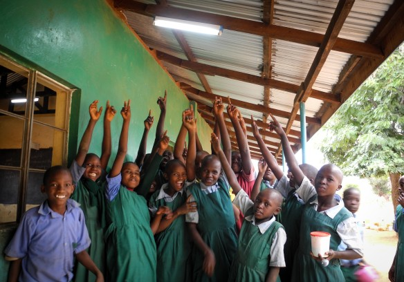 Pupils in Kitui, Kenya celebrate the launch of a community-based green energy project. (Picture by Joseph Kabiru)
