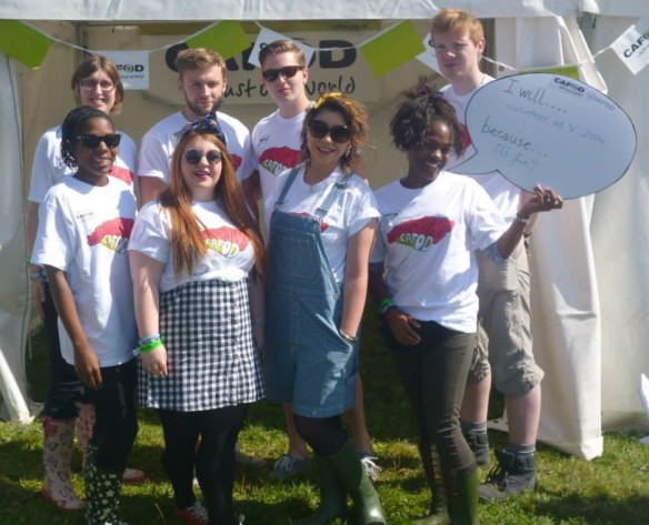Rhian (holding the speech bubble) and the other young CAFOD volunteers at V Festival