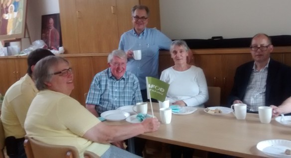 Malcolm Green (standing) shares a Harvest Fast Day meal with parishioners at Our Lady of Mount Carmel and St George, Enfield