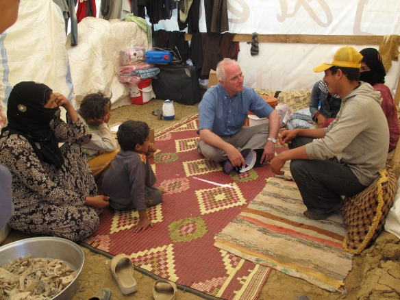 Geoff in refugee camp Lebanon