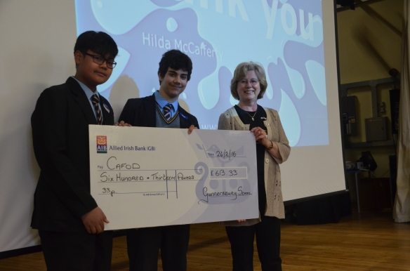 Hilda is pictured accepting cheque for £613 with students from the 'Apostles of Mercy' group.