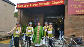 CAFOD Pedal Against Poverty team with Father Augustin St John Fisher Catholic Church