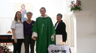 Media Volunteer Ellen with Father Sebastian and fellow CAFOD Volunteers at the CAFOD Memorial Mass