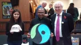 Father Chinedu with CAFOD Volutneer Michael Walsh and parishioner, hosting Fairtrade stall