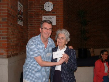 CAFOD's Tony Sheen with Mary O'Neil - presenting a cheque to CAFOD from Holy Family