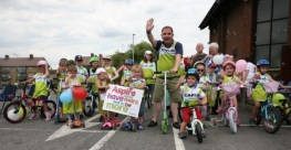 Father Derek Hyett and young parishioners cycle for CAFOD