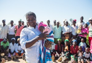 Photo - Thom Flint Marian stands with other members of Chinyama community veg garden with her twomonthold baby girl Talent