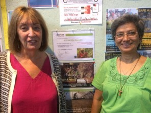 CAFOD Volunteer Elaine Carr with fellow parishioner from St Paul the Apostle Parish, Wood Green with Fairtrade poster